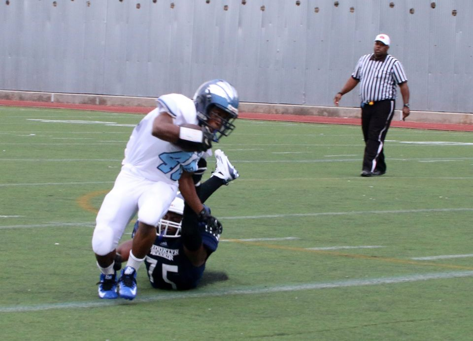 PC: Aleksander Kamornik Robert Deokinandin forces a fumble and recovers vs Canarsie.
